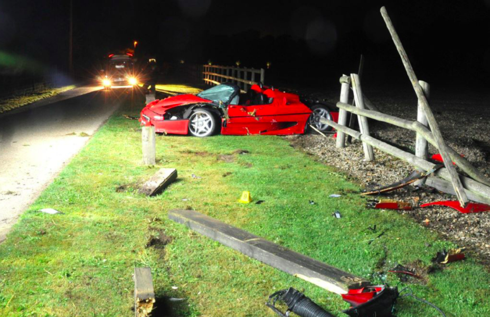 <em>The Ferrari F50 was pictured mangled and surrounded by broken fencing after the accident (PA)</em>