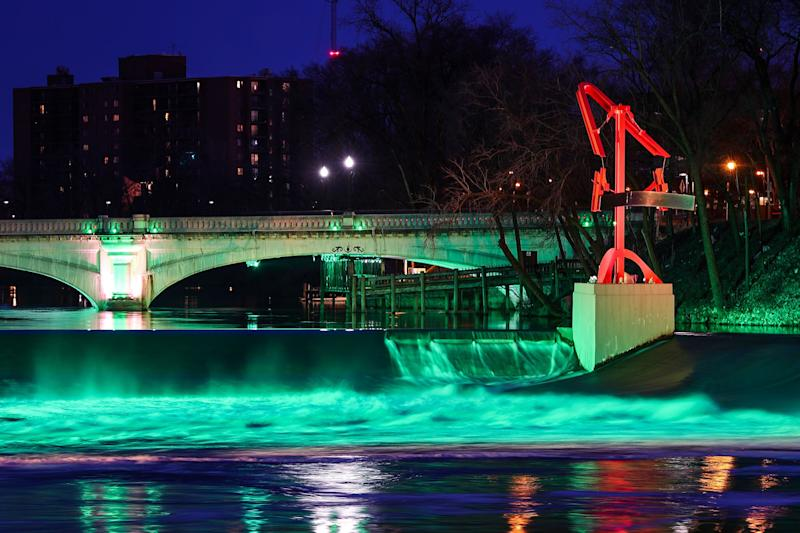 The South Bend River Lights are seen along the St. Joseph River in downtown South Bend, Ind. on Tuesday, March 12, 2019. The lights are part of a $25 million project led by Mayor Pete Buttigieg to improve infrastructure downtown and make it more vibrant and inviting to visitors and residents.
