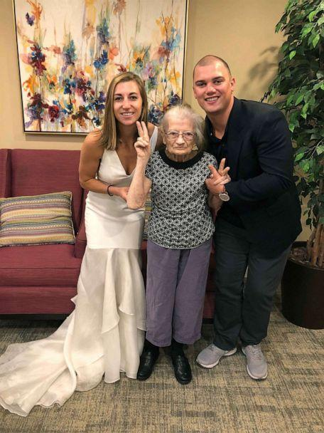 PHOTO: Lauren Parks, her grandmother and her husband Tommy pose at her grandmother's memory care facility. (Courtesy Lauren Parks )