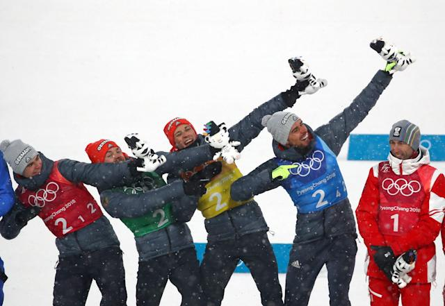 Nordic Combined Events - Pyeongchang 2018 Winter Olympics - Men's Team 4 x 5 km Final - Alpensia Cross-Country Skiing Centre - Pyeongchang, South Korea - February 22, 2018 - Gold medallists Vinzenz Geiger, Fabian Riessle, Eric Frenzel and Johannes Rydzek of Germany celebrate during the flower ceremony. REUTERS/Carlos Barria
