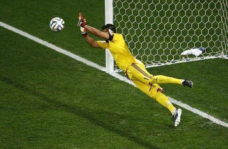 Argentina's goalkeeper Sergio Romero saves a shot by Wesley Sneijder of the Netherlands during a penalty shootout in their 2014 World Cup semi-finals at the Corinthians arena in Sao Paulo July 9, 2014. REUTERS/Ricardo Moraes