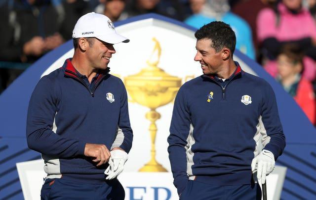 Former Ryder Cup team-mates Paul Casey, left, and Rory McIlroy are in medal contention