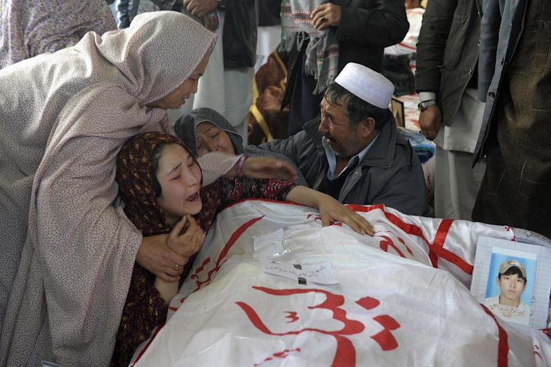 A Pakistani woman is comforted by other relatives while grieving over the body of her brother Mohammed Ali, who was killed in Saturday's bombing, in Quetta, Pakistan, Tuesday, Feb. 19, 2013. Pakistan on Tuesday ordered an operation in the southwestern city of Quetta following a weekend bombing targeting minority Shiite Muslims that killed scores of people there, and sacked the top police officer in the surrounding Baluchistan province as victims of the bombing refuse to bury their dead in protest. (AP Photo/Arshad Butt)