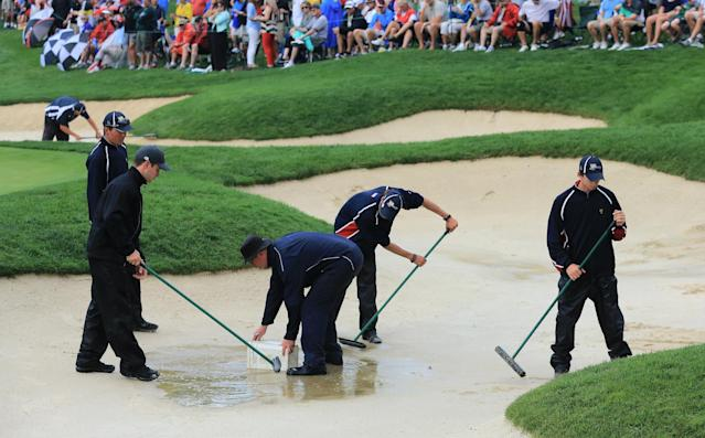 DUBLIN, OH - OCTOBER 05: Members of the grounds staff work on a bunker during the Day Three Four-ball Matches at the Muirfield Village Golf Club on October 5, 2013 in Dublin, Ohio. (Photo by David Cannon/Getty Images)