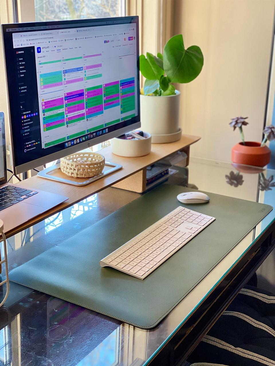 """<h2>Amazon Dual-Sided PU Leather Desk Pad</h2><br><strong>Last Month's Top MVP:</strong><br>""""If you haven't already caught my <a href=""""https://www.refinery29.com/en-us/best-desk-pads"""" rel=""""nofollow noopener"""" target=""""_blank"""" data-ylk=""""slk:dedicated review on this $17 Amazon desk pad"""" class=""""link rapid-noclick-resp"""">dedicated review on this $17 Amazon desk pad</a>, then here's the instant tea: it provided me with a sleek canvas for arranging my work stuff without much thought, acted as visual encouragement for me to keep things in place, arrived very quickly, unfurled onto my desk sans strange creases or wonky raised edges, and had a substantial weight-feel with an overall expensive-leather-like look to it."""" <em>– Elizabeth Buxton, Market Editor</em><br><br><em>Shop <strong><a href=""""https://amzn.to/35fKxnN"""" rel=""""nofollow noopener"""" target=""""_blank"""" data-ylk=""""slk:Amazon"""" class=""""link rapid-noclick-resp"""">Amazon</a></strong></em><br><br><strong>EMINTA</strong> Dual-Sided PU Leather Desk Pad, $, available at <a href=""""https://amzn.to/3anwFvb"""" rel=""""nofollow noopener"""" target=""""_blank"""" data-ylk=""""slk:Amazon"""" class=""""link rapid-noclick-resp"""">Amazon</a>"""