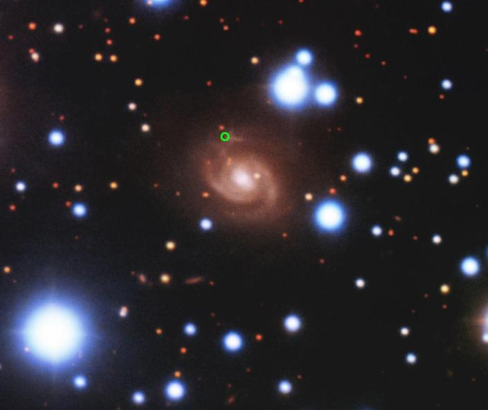 A photo showing several galaxies and stars against the background of space