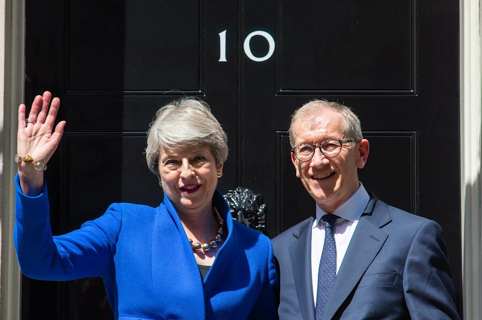 Outgoing Prime Minister Theresa May issues a statement outside 10 Downing Street, London, watched by her husband Philip, prior to a meeting at Buckingham Palace where she will hand in her resignation to Queen Elizabeth II.