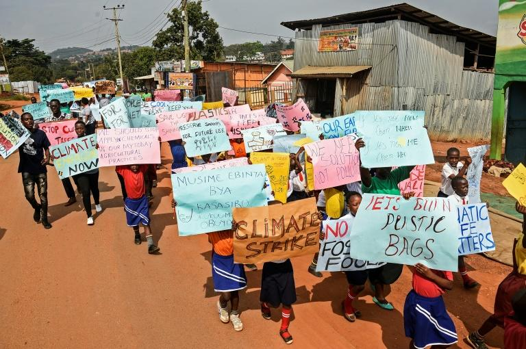 Uganda's youth were joining children around the world following the rallying cry of Swedish teen activist Greta Thunberg to skip school and protest for action on climate issues (AFP Photo/ISAAC KASAMANI)