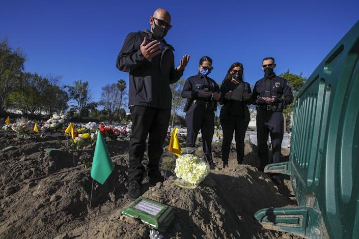 The Shilleh family offer prayers at the grave of their father
