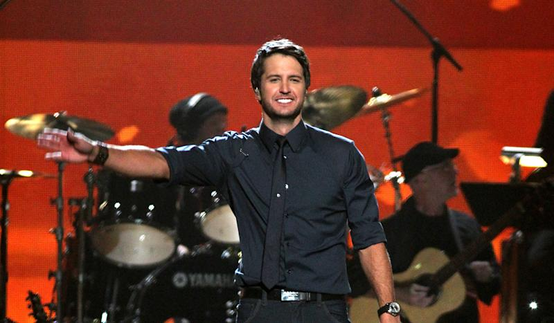 """FILE - In this April 2, 2012 file photo, Luke Bryan performs """"Running with the Night"""" at ACM Presents: Lionel Richie and Friends in Concert in Las Vegas. Luke Bryan leads the 2012 American Country Awards nominees with seven nominations; Lady Antebellum and Zac Brown Band each earned six nods; and Eric Church and Taylor Swift garnered five nominations.  The American Country Awards will air live from Mandalay Bay in Las Vegas Monday, Dec. 10, 2012 (8:00-10:00 PM ET live/PT tape-delayed) on FOX.  (AP Photo/Jeff Bottari, File)"""