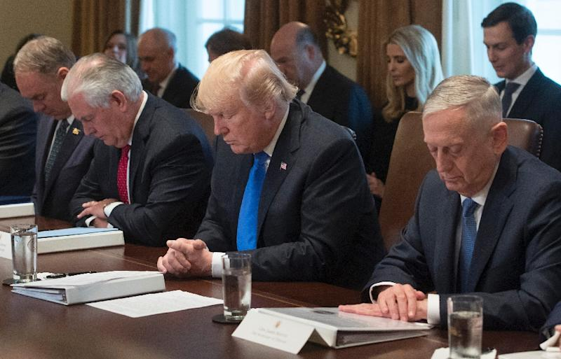 US President Donald Trump Bows His Head For A Prayer Delivered During A  Cabinet Meeting At