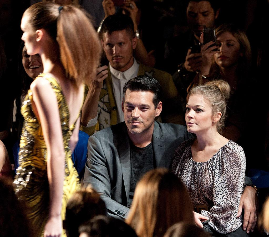 "Can't LeAnn Rimes and new husband Eddie Cibrian go <i>anywhere</i> without turning it into a romantic date? The two even canoodled at the unveiling of Monique Lhuillier Spring 2012 collection on Friday, where they kept their eyes on the runway during the precious few moments they weren't focused on each other. D Dipasupil/<a href=""http://www.filmmagic.com/"" target=""new"">FilmMagic.com</a> - September 9, 2011"