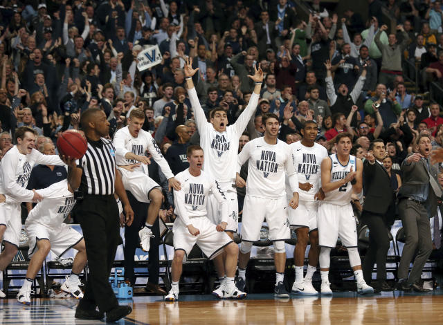 Players on the Villanova bench celebrates a Villanova basket against West Virginia during the second half of an NCAA men's college basketball tournament regional semifinal Friday, March 23, 2018, in Boston. (AP Photo/Mary Schwalm)