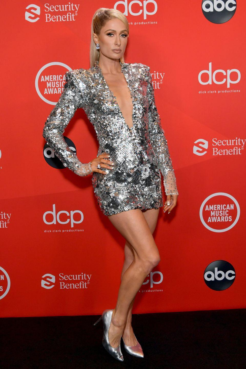 <p><strong>22 November </strong>Paris Hilton matched her Valdrin Sahiti sequinned mini-dress with silver court shoes. </p>