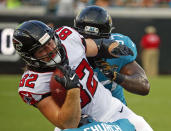 Atlanta Falcons' Logan Paulsen (82) is stopped by Jacksonville Jaguars defensive tackle Malik Jackson, right, after a reception during the first half of an NFL preseason football game Saturday, Aug. 25, 2018, in Jacksonville, Fla. (AP Photo/Stephen B. Morton)