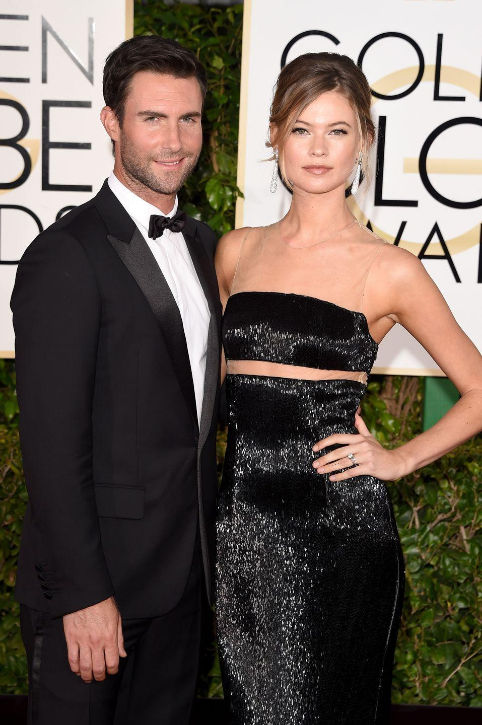 "<p>Known for his modelizing ways before finally settling down, Levine, then 34, met Prinsloo, then 24, in June 2012 after he ended his relationship with Prinsloo's close friend and fellow VS model Anne Vyalitsyna. The couple got engaged in 2013 and later <a href=""http://people.com/celebrity/adam-levine-married-maroon-5-rocker-weds-behati-prinsloo-in-mexico/"" rel=""nofollow noopener"" target=""_blank"" data-ylk=""slk:tied the knot"" class=""link rapid-noclick-resp"">tied the knot</a> in 2014 in Los Cabos, Mexico. Prinsloo gave birth to baby girl <a href=""http://celebritybabies.people.com/2016/09/22/adam-levine-behati-prinsloo-welcome-daughter-dusty-rose/"" rel=""nofollow noopener"" target=""_blank"" data-ylk=""slk:Dusty Rose"" class=""link rapid-noclick-resp"">Dusty Rose</a> in 2016, and gave birth to another daughter, <a href=""https://www.harpersbazaar.com/celebrity/latest/a18657945/behati-prinsloo-adam-levine-second-child/"" rel=""nofollow noopener"" target=""_blank"" data-ylk=""slk:Gio Grace"" class=""link rapid-noclick-resp"">Gio Grace</a>, in February 2018.</p>"
