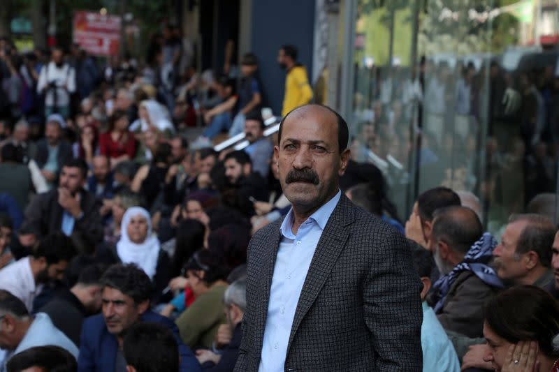 FILE PHOTO: Pro-Kurdish lawmaker Farisogullari takes part in a protest against the detention of their local politicians in Diyarbakir