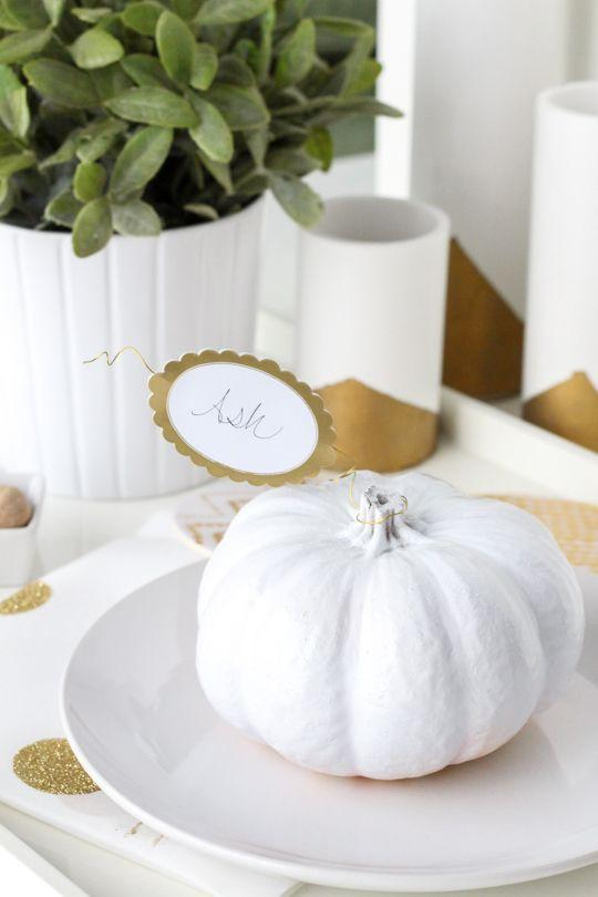 "<p>These place cards may look like they took a ton of time to put together, but in reality, they couldn't be easier to make. A gorgeous, decorative pumpkin does most of the work for you!</p><p><strong>Get the tutorial at <a href=""https://sugarandcloth.com/diy-simple-pumpkin-leaf-place-cards/"" rel=""nofollow noopener"" target=""_blank"" data-ylk=""slk:Sugar and Cloth"" class=""link rapid-noclick-resp"">Sugar and Cloth</a>. </strong></p><p><strong><a class=""link rapid-noclick-resp"" href=""https://www.amazon.com/Elanze-Designs-Decorative-Pumpkins-Quantity/dp/B07CHVVC1S?tag=syn-yahoo-20&ascsubtag=%5Bartid%7C10050.g.1538%5Bsrc%7Cyahoo-us"" rel=""nofollow noopener"" target=""_blank"" data-ylk=""slk:SHOP WHITE PUMPKINS"">SHOP WHITE PUMPKINS</a><br></strong></p>"