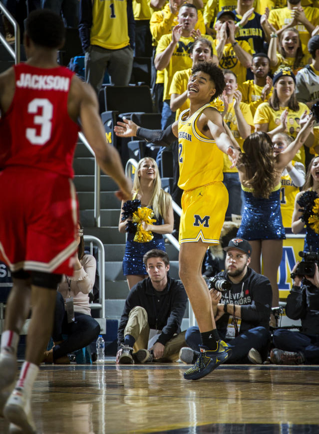 Michigan guard Jordan Poole, right, celebrates making a three point basket in the second half of an NCAA college basketball game against Ohio State at Crisler Center in Ann Arbor, Mich., Sunday, Feb. 18, 2018. Michigan won 74-62. (AP Photo/Tony Ding)