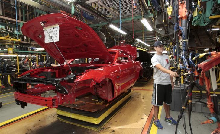 The frame of a 2015 Ford Mustang vehicle moves down the production line at the Ford Motor Flat Rock Assembly Plant in Flat Rock, Michigan,