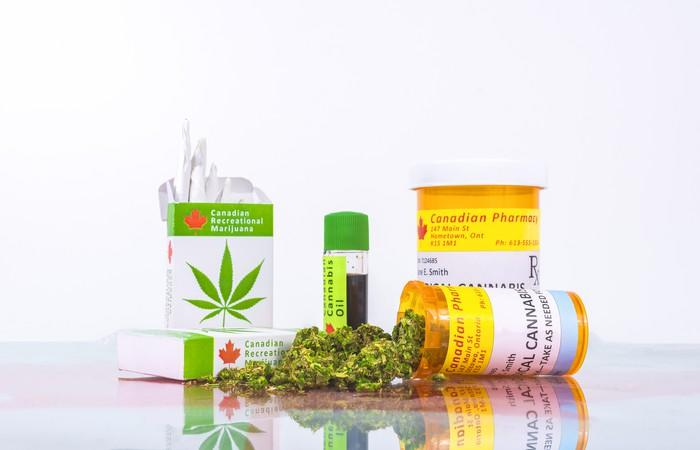 An assortment of cannabis products and packaging laid out on a counter.