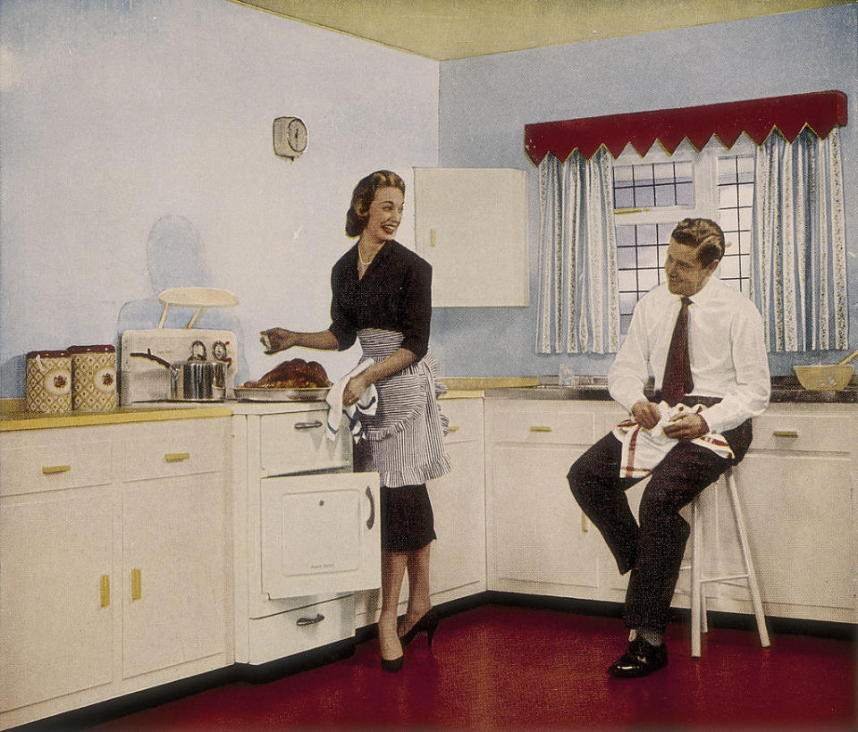 'Who couldn't cook well in a kitchen like this', 1950s. A couple happily preparing a roast. An advertisement for the paint company Robbialac. (Photo by Museum of London/Heritage Images/Getty Images)