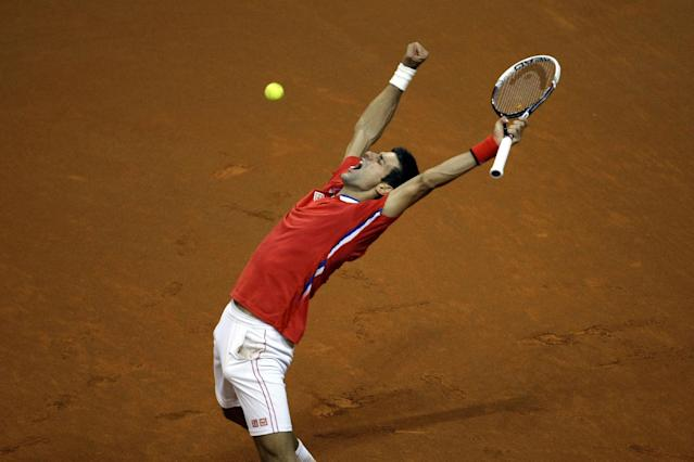 Serbia's Novak Djokovic lifts his hands in jubilation after winning the Davis Cup semifinals tennis match against Canada's Milos Raonic in Belgrade, Serbia, Sunday, Sept. 15, 2013. (AP Photo/ Marko Drobnjakovic)