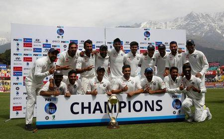 Cricket - India v Australia - Fourth Test cricket match - Himachal Pradesh Cricket Association Stadium, Dharamsala, India - 28/03/17 - Indian players pose with the trophy after winning the series. REUTERS/Adnan Abidi