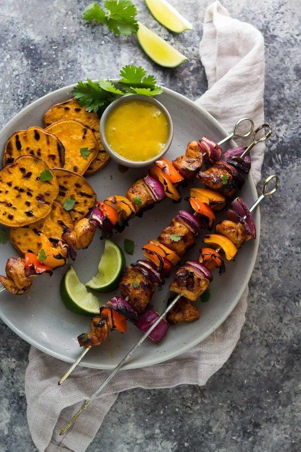 """<p>Skewers make grilling much more manageable, and this combination of chicken, peppers and onion is juicy and irresistible. </p> <p><strong>Get the recipe:</strong> <a href=""""https://sweetpeasandsaffron.com/chili-lime-chicken-skewers-mango-sauce/"""" class=""""link rapid-noclick-resp"""" rel=""""nofollow noopener"""" target=""""_blank"""" data-ylk=""""slk:chili lime chicken skewers with mango sauce"""">chili lime chicken skewers with mango sauce</a></p>"""