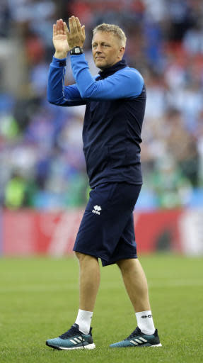 Iceland coach Heimar Hallgrimsson applauds to the spectators after the group D match between Argentina and Iceland at the 2018 soccer World Cup in the Spartak Stadium in Moscow, Russia, Saturday, June 16, 2018. (AP Photo/Matthias Schrader)