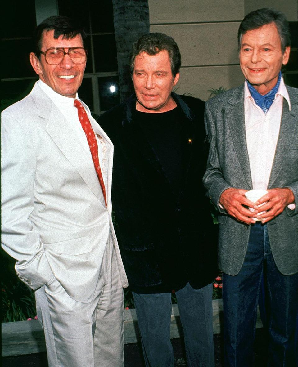 <p>Leonard Nimoy, William Shatner, and DeForest Kelley attend the dedication of the Roddenberry building at Paramount Studios on June 6, 1991. <i>(Photo: Albert L. Ortega/WireImage)</i></p>