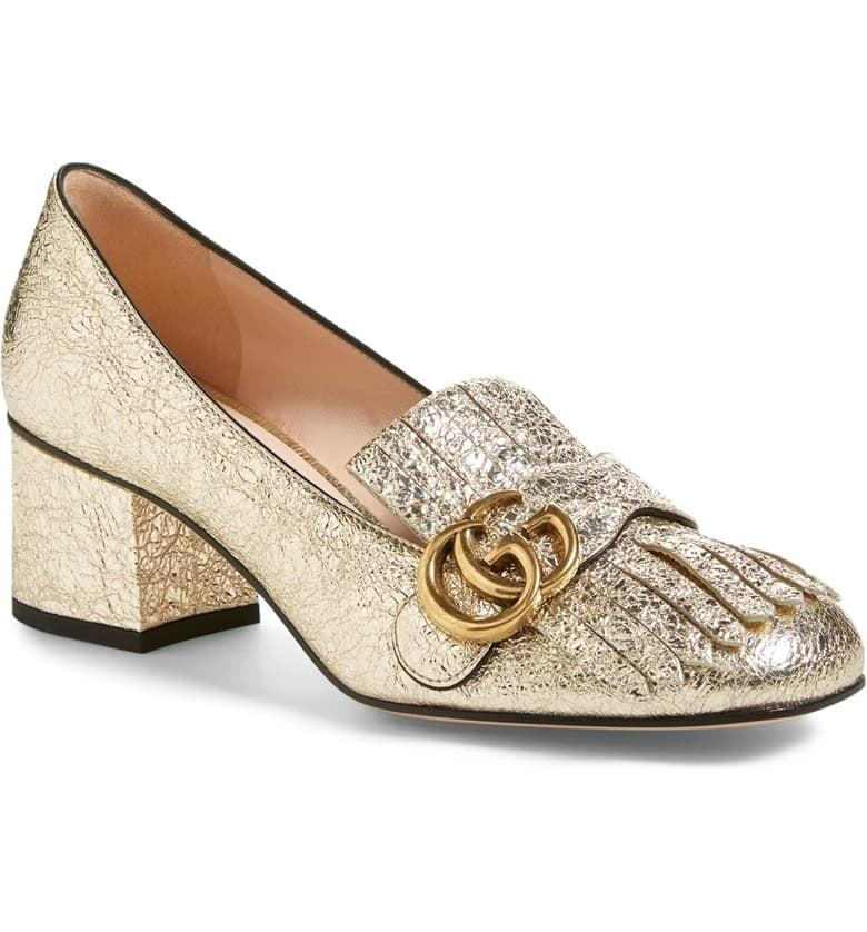 "<p>Add a touch of glitz to your outfit by wearing these <a href=""https://www.popsugar.com/buy/Gucci-GG-Marmont-Pumps-492971?p_name=Gucci%20GG%20Marmont%20Pumps&retailer=shop.nordstrom.com&pid=492971&price=830&evar1=fab%3Aus&evar9=44087420&evar98=https%3A%2F%2Fwww.popsugar.com%2Ffashion%2Fphoto-gallery%2F44087420%2Fimage%2F46653252%2FGucci-GG-Marmont-Pumps&list1=shopping%2Cfall%20fashion%2Caccessories%2Cgucci&prop13=mobile&pdata=1"" rel=""nofollow"" data-shoppable-link=""1"" target=""_blank"" class=""ga-track"" data-ga-category=""Related"" data-ga-label=""https://shop.nordstrom.com/s/gucci-gg-marmont-pump-women/4177601?origin=category-personalizedsort&amp;breadcrumb=Home%2FBrands%2FGucci&amp;color=gold%20leather"" data-ga-action=""In-Line Links"">Gucci GG Marmont Pumps</a> ($830).</p>"