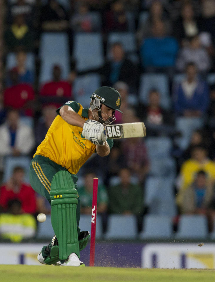 South Africa's batsman Albie Morkel, is bowled by Australia's bowler Mitchell Starc, for 18 runs during their T20 Cricket match at Centurion Park in Pretoria, South Africa, Friday, March 14, 2014. (AP Photo/Themba Hadebe)