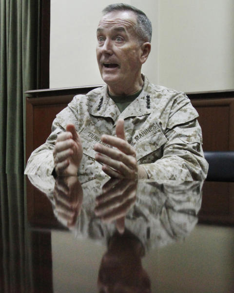 Top U.S. military commander in Afghanistan, Joseph Dunford, gestures during an interview with the Associated Press at his headquarters in Kabul, Afghanistan, Monday, March 18, 2013. The top U.S. military commander in Afghanistan says he's working quickly to resolve issues that have infuriated Afghan President Hamid Karzai, including the delayed handover of a U.S.-run detention center and the withdrawal of U.S. special operations forces from a province outside Kabul. (AP Photo/Ahmad Jamshid)
