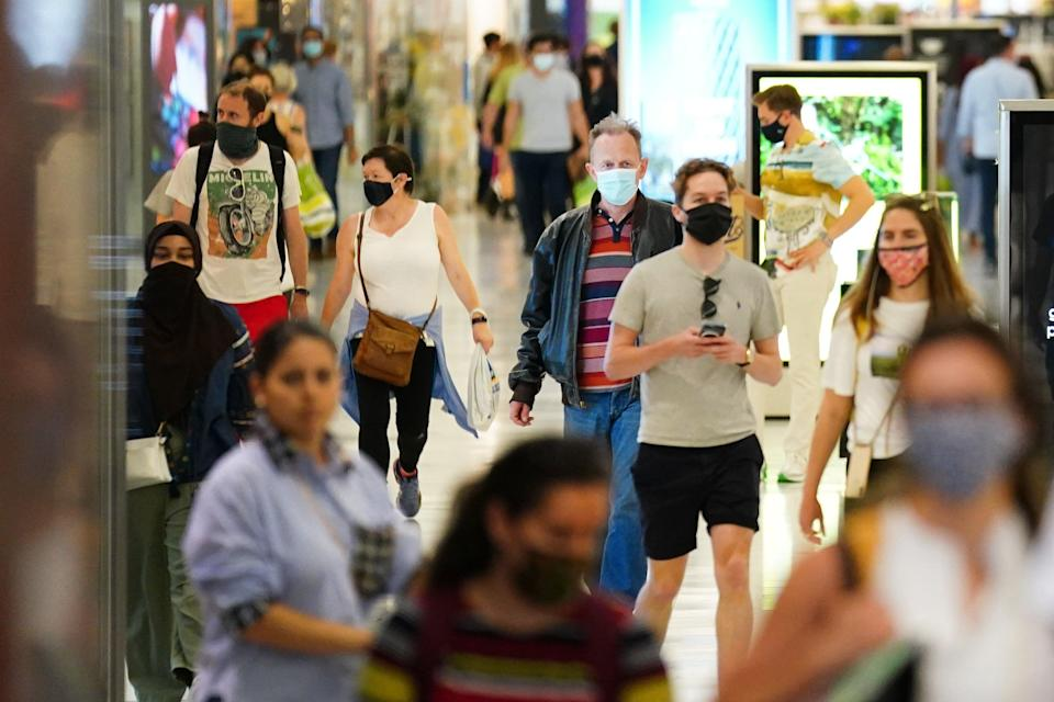 Shoppers wearing facemasks inside a shopping centre in East London (Victoria Jones/PA) (PA Wire)