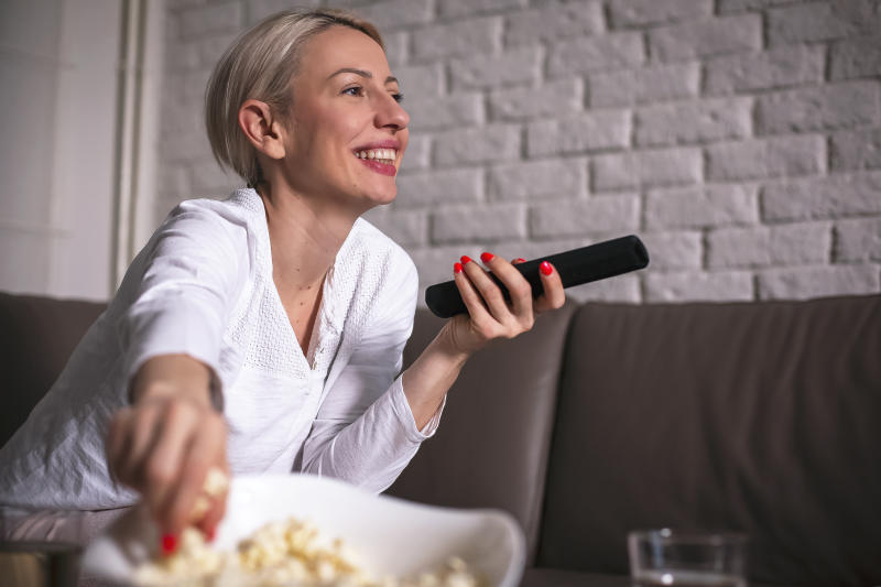 Woman in pyjamas watching movies (Photo: Getty Images)