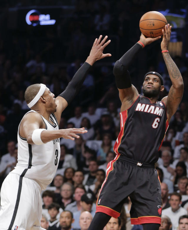 Miami Heat forward LeBron James (6) shoots against Brooklyn Nets forward Paul Pierce in the first period during Game 3 of an Eastern Conference semifinal NBA playoff basketball game on Saturday, May 10, 2014, in New York. (AP Photo/Julie Jacobson)