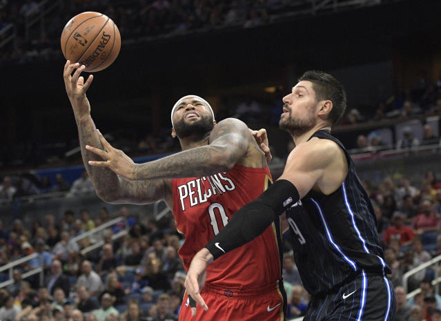 "<a class=""link rapid-noclick-resp"" href=""/nba/teams/nor/"" data-ylk=""slk:New Orleans Pelicans"">New Orleans Pelicans</a> center <a class=""link rapid-noclick-resp"" href=""/nba/players/4720/"" data-ylk=""slk:DeMarcus Cousins"">DeMarcus Cousins</a> (0) is fouled by <a class=""link rapid-noclick-resp"" href=""/nba/teams/orl/"" data-ylk=""slk:Orlando Magic"">Orlando Magic</a> center <a class=""link rapid-noclick-resp"" href=""/nba/players/4897/"" data-ylk=""slk:Nikola Vucevic"">Nikola Vucevic</a> (9) while going up for a shot during the second half of an NBA basketball game Friday, Dec. 22, 2017, in Orlando, Fla. (AP Photo/Phelan M. Ebenhack)"