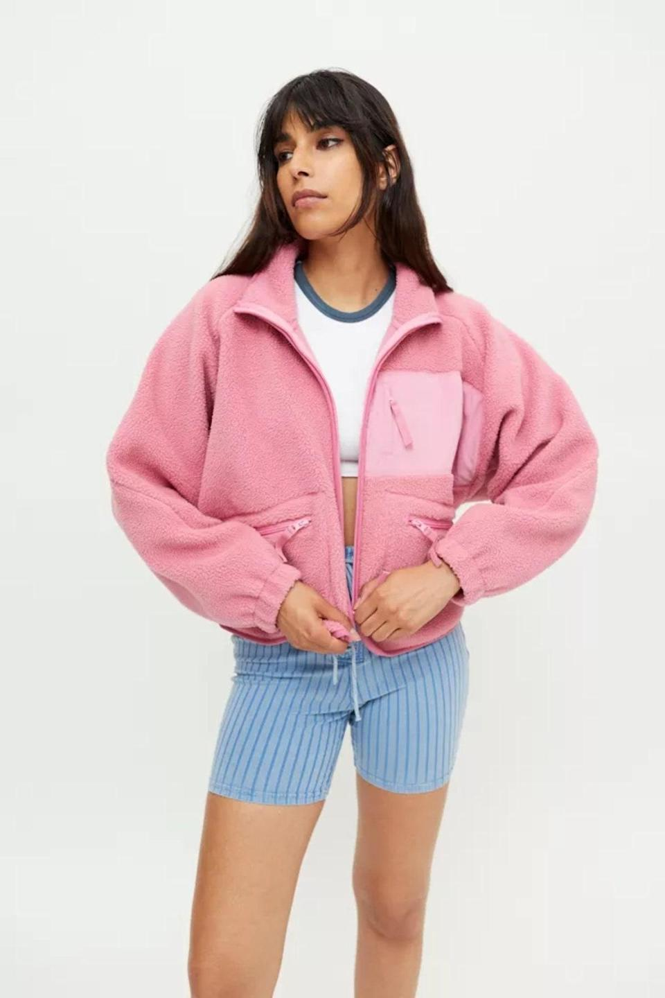 """A fleece sweater is a staple, and this Free People one comes in the dreamiest pink shade. $89, Urban Outfitters. <a href=""""https://www.urbanoutfitters.com/shop/uo-stormy-fleece-jacket?color=066&type=REGULAR&quantity=1"""" rel=""""nofollow noopener"""" target=""""_blank"""" data-ylk=""""slk:Get it now!"""" class=""""link rapid-noclick-resp"""">Get it now!</a>"""