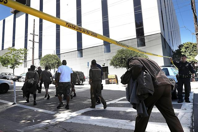 <p>UPS workers are escorted by San Francisco police at the scene of a shooting at a company facility on June 14, 2017 in San Francisco, California. (Photo by Justin Sullivan/Getty Images) </p>