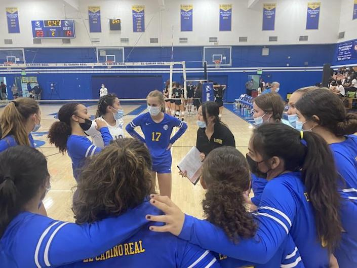 El Camino Real girls' volleyball coach Alyssa Lee talks to team during timeout.