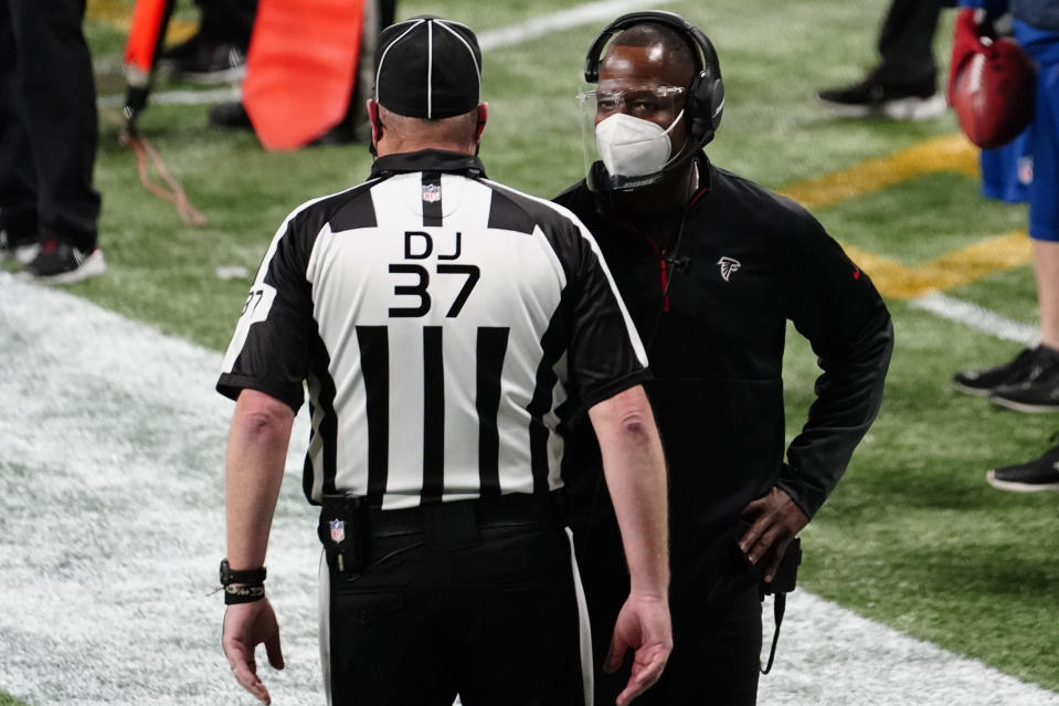 Atlanta Falcons interim head coach Raheem Morris speaks to an official during the second half of an NFL football game against the Las Vegas Raiders, Sunday, Nov. 29, 2020, in Atlanta. (AP Photo/Brynn Anderson)