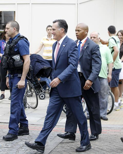 Avoiding a traffic jam, Republican presidential candidate, former Massachusetts Gov. Mitt Romney walks down Grosvenor Place in London to meet Ireland's Prime Minister Enda Kenny at the Embassy of Ireland, Friday, July 27, 2012. (AP Photo/Charles Dharapak)