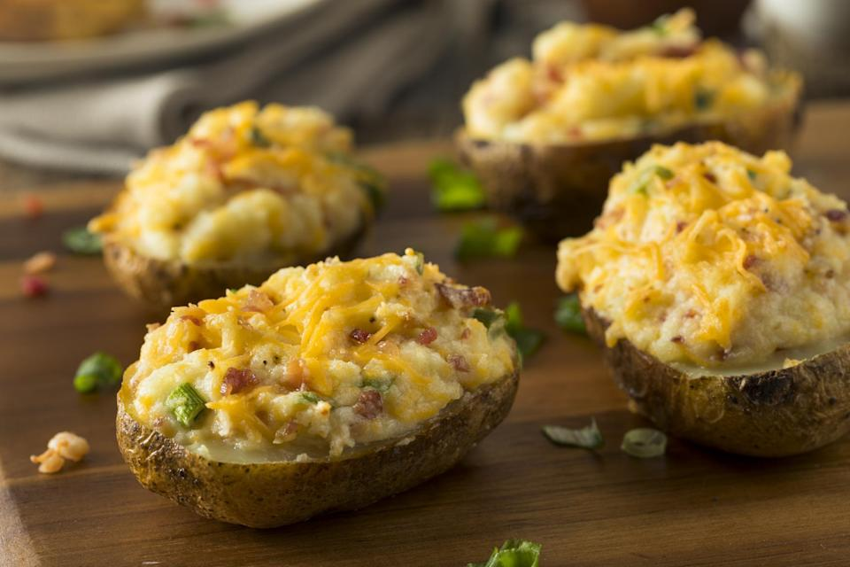 """<p>Why choose between baked potatoes, mashed potatoes, cheesy potatoes and meaty potatoes when you can have them all in one dish? Twice-baked potatoes require a little more effort to prepare, but it it will pay off in the end.</p> <p><em><a href=""""https://www.thedailymeal.com/recipes/perfect-twice-baked-potatoes-recipe?referrer=yahoo&category=beauty_food&include_utm=1&utm_medium=referral&utm_source=yahoo&utm_campaign=feed"""" rel=""""nofollow noopener"""" target=""""_blank"""" data-ylk=""""slk:For the Twice-Baked Potatoes recipe, click here."""" class=""""link rapid-noclick-resp"""">For the Twice-Baked Potatoes recipe, click here.</a></em></p>"""