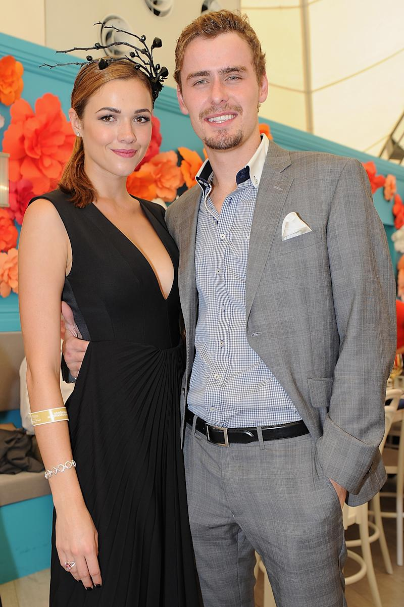 Demi Harman and Alec Snow pose during Magic Millions Race Day at Gold Coast Racecourse on January 10, 2015