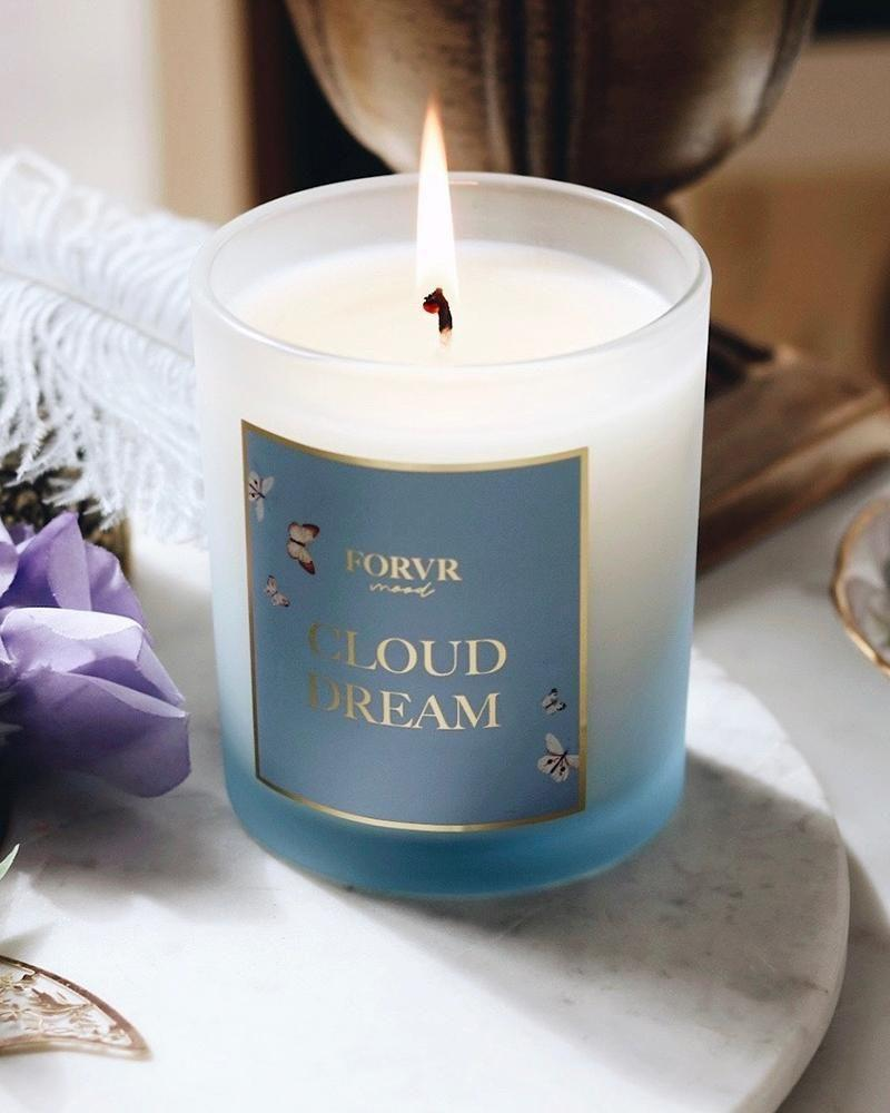 """<p><strong>Forvr Mood</strong></p><p>forvrmood.com</p><p><strong>$38.00</strong></p><p><a href=""""https://forvrmood.com/collections/candles/products/cloud-dream-candle"""" rel=""""nofollow noopener"""" target=""""_blank"""" data-ylk=""""slk:Shop Now"""" class=""""link rapid-noclick-resp"""">Shop Now</a></p><p>If you're into sweet and fruity scents, you'll love this one that has notes of lychee, raspberry, vanilla bean, and more.</p>"""