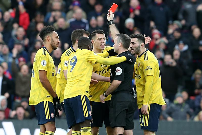 Referee Paul Tierney shows Arsenal's Pierre-Emerick Aubameyang (far left) a red card after VAR review on Saturday. (Photo by Charlotte Wilson/Offside/Offside via Getty Images)