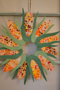"""<p>Use bubble wrap and washable paint to make each ear of corn look just like one you'd find in a field. </p><p><em><a href=""""http://1pureheart.blogspot.com/2011/10/corn-wreath.html"""" rel=""""nofollow noopener"""" target=""""_blank"""" data-ylk=""""slk:Get the tutorial at Purely From the Heart »"""" class=""""link rapid-noclick-resp"""">Get the tutorial at Purely From the Heart »</a></em> </p>"""