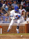 Chicago Cubs' Arismendy Alcantara is hit by a pitch from Colorado Rockies starting pitcher Jorge De La Rosa during the second inning of a baseball game Tuesday, July 29, 2014, in Chicago. (AP Photo/Charles Rex Arbogast)