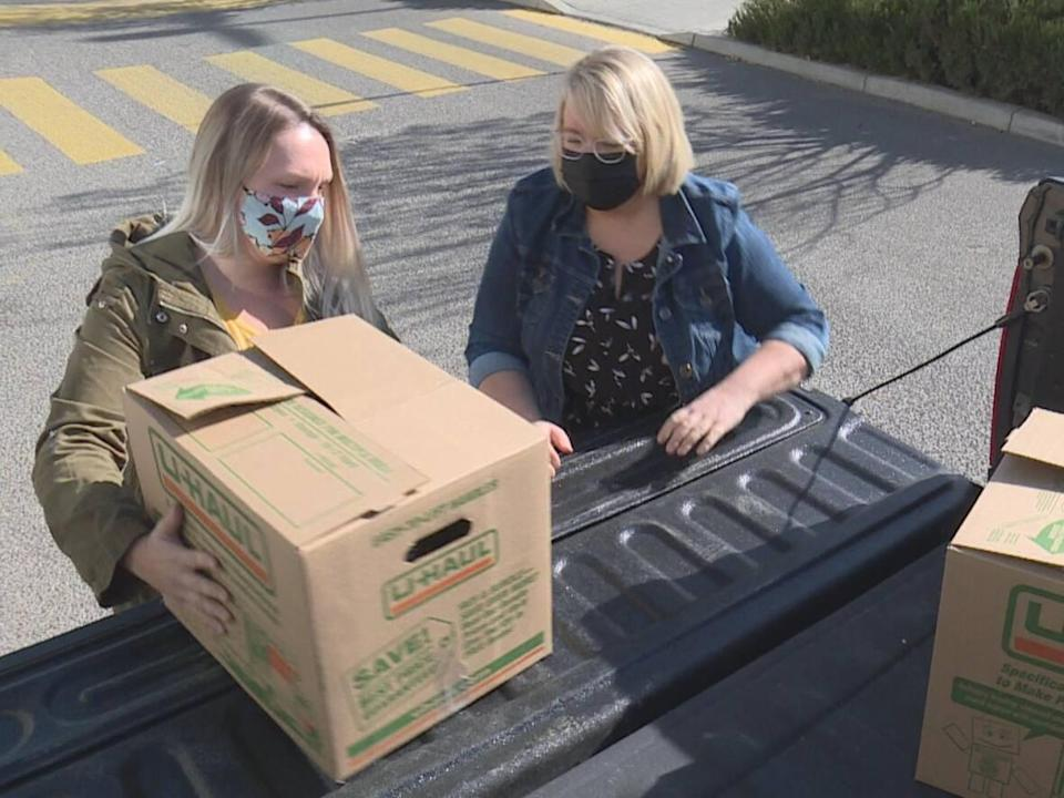 Brianna Kelly, right, packaged and delivered 120 Thanksgiving food hampers this holiday weekend in Calgary. (Terri Trembath/CBC - image credit)
